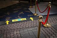 Corona Lockdown, December 17th. 2020. Reminder to keep your distance on floor in front of the entrance to Kaufhof department store on Schildergasse, Cologne, Germany.<br /> <br /> Corona Lockdown, 17. Dezember 2020. Hinweis auf dem Boden vor dem Eingang zum Kaufhof Abstand zu halten,  Koeln, Deutschland.