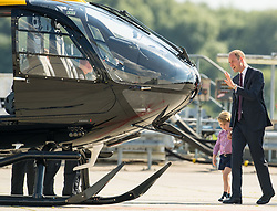 The Duke of Cambridge shows Prince George a rescue helicopter during a visit to Airbus in Hamburg, Germany with the Duchess of Cambridge and sister Princess Charlotte.