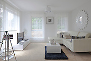 white furnished lounge, living room in show house