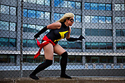 Anna Sheldrick as Ms Marvel from The Avengers(Ms. Marvel is the name of a fictional character appearing in comic books published by Marvel Comics) attending the London Film and Comic Con LFCC is a convention held annually in London that focuses on films, cult television and comics. The convention holds a large dealers hall selling movie, comic and science fiction related memorabiliaand original film props, along with free guest talks, professional photoshoots, autograph sessions, displays. Many of the visitors / attendeesarrive dressed up as their favourite comic and sci-fi characters in the most outlandish costumes which draws from the award-winning formula of innovative gameplay.