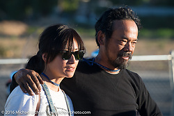 Ayu and Shinya Kimura (Team 80) after stage 15 (244 miles) of the Motorcycle Cannonball Cross-Country Endurance Run, which on this day ran from Lewiston, Idaho to Yakima, WA, USA. Saturday, September 20, 2014.  Photography ©2014 Michael Lichter.