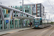 A Nottingham Express Transit NET tram heading towards Clifton South in Nottingham, Nottinghamshire, United Kingdom. The tram network in Nottingham has 51 stops and provides an alternative, more sustainable mode of transport for commuters and tourists.