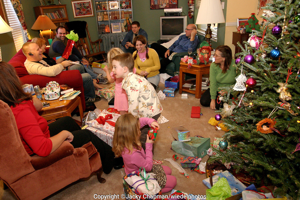 Family opening and giving presents to each other on Christmas day