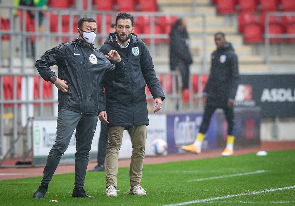 Huddersfield Town manager Carlos Corberán checks the watch of fourth official Tony Harrington deep into stoppage time<br /> <br /> Photographer Alex Dodd/CameraSport<br /> <br /> The EFL Sky Bet Championship - Rotherham United v Huddersfield Town - Saturday 3rd October 2020 - New York Stadium - Rotherham<br /> <br /> World Copyright © 2020 CameraSport. All rights reserved. 43 Linden Ave. Countesthorpe. Leicester. England. LE8 5PG - Tel: +44 (0) 116 277 4147 - admin@camerasport.com - www.camerasport.com
