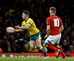 Bernard Foley of Australia passes<br /> <br /> Photographer Simon King/Replay Images<br /> <br /> Under Armour Series - Wales v Australia - Saturday 10th November 2018 - Principality Stadium - Cardiff<br /> <br /> World Copyright © Replay Images . All rights reserved. info@replayimages.co.uk - http://replayimages.co.uk