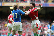 Mike Phillips of Wales (r) clashes with Italy's Mirco Bergamasco (11).   RBS Six nations championship 2010, Wales v Italy at the Millennium Stadium in Cardiff  on Sat 20th March 2010. pic by Andrew Orchard, Andrew Orchard sports photography,