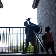 Aliyah Randle (right) and her mom, Laurell Florence drag their belongings up three flights of stairs to their new apartment, January 22, 2016, in Tempe, Arizona. Aliyah ran from room to room, exploring.