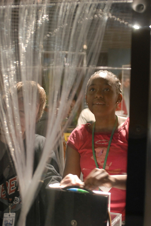 Sixth grade girl looks at a fiber optic display at the Houston Museum of Science at Hermann Park. <br /> ©Bob Daemmrich