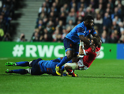 Mathieu Bastareaud of France tackles Matt Evans of Canada  - Mandatory byline: Joe Meredith/JMP - 07966386802 - 01/10/2015 - Rugby Union, World Cup - Stadium:MK -Milton Keynes,England - France v Canada - Rugby World Cup 2015