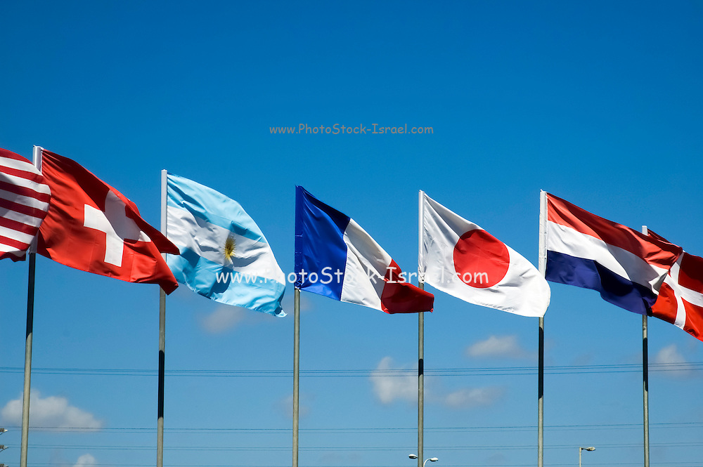 a row of 5 flags waving