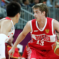 31 July 2012: Russia Dmitry Khvostov looks to pass the ball during the 73-54 Russia victory over China, during the men's basketball preliminary, at the Basketball Arena, in London, Great Britain.