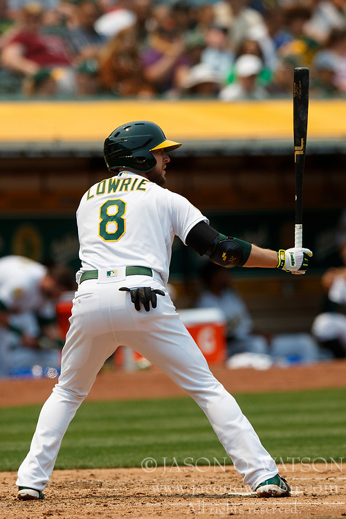 OAKLAND, CA - JULY 01:  Jed Lowrie #8 of the Oakland Athletics at bat against the Cleveland Indians during the third inning at the Oakland Coliseum on July 1, 2018 in Oakland, California. The Cleveland Indians defeated the Oakland Athletics 15-3. (Photo by Jason O. Watson/Getty Images) *** Local Caption *** Jed Lowrie