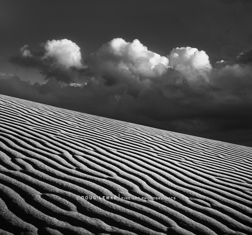 Sand ripples and storm clouds just before sunset in Death Valley National Park, California, USA