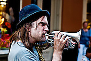 busker plays a trumpet