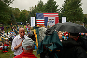 Cory Booker, left, speaks on MSNBC saying he needs to raise more money to stay in the presidential race during the Polk County Steak Fry, Saturday, September 21, 2019 at Water Works Park in Des Moines, Iowa. The steak fry was the largest in Iowa's history and was attended by 12,000 Democrats from around Iowa. The event drew in 17 candidates for the democratic nomination for president of the United States. The Iowa Caucasus are Monday, February 3, 2020 and although not a primary will narrow down the field of candidates for president before the first election primary in the state of New Hampshire.