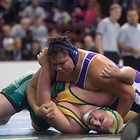 022115      Cayla Nimmo<br /> <br /> Miyamura Patriot Jasper Denetclaw pins opponent Jonathan Schueler from Los Alamos for the State Championship win in the 285 weight class on Saturday in Albuquerque.