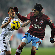 Besiktas's Simao SABROSA (L) and Trabzonspor's Gustavo COLMAN (R) during their Turkish Superleague Derby match Besiktas between Trabzonspor at the Inonu Stadium at Dolmabahce in Istanbul Turkey on Sunday, 06 March 2011. Photo by TURKPIX