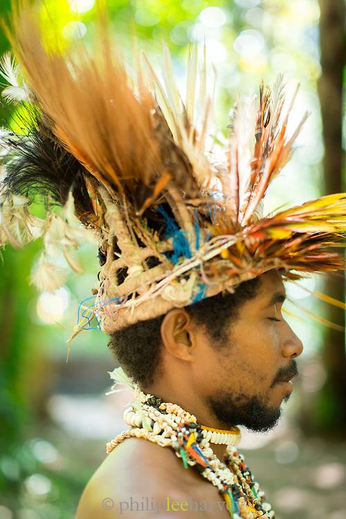 Profile of man wearing traditional headdress, Mclaren Harbour, Tufi, Cape Nelson, Oro Province, Papua New Guinea