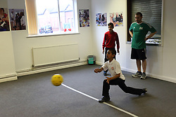 Boys with visual impairments being taught Goalball at Mysight, Nottingham.