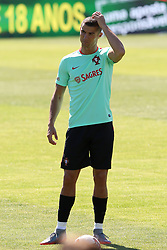 June 7, 2017 - Lisbon, Portugal - Portugal's forward Cristiano Ronaldo scratches his new haircut during a training session at ''Cidade do Futebol'' (Football City) training camp in Oeiras, outskirts of Lisbon on June 7, 2017, ahead of the FIFA World Cup Russia 2018 qualifier match Latvia vs Portugal. Photo: Pedro Fiuza. (Credit Image: © Pedro Fiuza via ZUMA Wire)