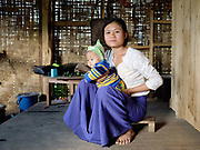 Helen, an ethnic Kayan woman with Faustina her 5 month old daughter at her home in Song Duu village, Kayah State, Myanmar on 16th November 2016