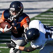 Orange Coast College's Joey Hunt, left, pushes past Fullerton College's Tim Gordon during the Orange Coast College vs. Fullerton College football game at Orange Coast College in California on Saturday.
