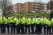 Police lines keeping two opposing groups separate as Anti Facist demonstrators march through Dover protesting against a facist demonstration also taking place in the port town. 30th January 2016