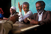 Playing dominoes in the ancient city of Harar,  Situated in Eastern Ethiopia it is considered to be the fourth  holiest city in Islam with 82 mosques. It is a major commercial centre linked by trade routes with the rest of Ethiopia and the entire Horn of Africa.  Ethiopia