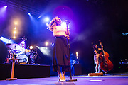 Brooklyn, NY – 7 June 2017. Brooklyn-based Lake Street Dive opened the 2017 season of the BRIC Celebrate Brooklyn! Festival at the Prospect Park Bandshell to a packed venue. The band features Rachel Price on lead vocals; also on stage are bassist Bridget Kearney and drummer Mike Calabrese.