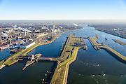 Nederland, Noord-Holland, IJmuiden, 11-12-2013;  sluizencomplex en ingang Noorzeekanaal. De spuisluis en de Noordersluis, Tata Steel in de achtergrond.<br /> Entrance  Noorzee-channel with locks and discharge sluice, Tata Steel in the background.<br /> luchtfoto (toeslag op standaard tarieven);<br /> aerial photo (additional fee required);<br /> copyright foto/photo Siebe Swart.