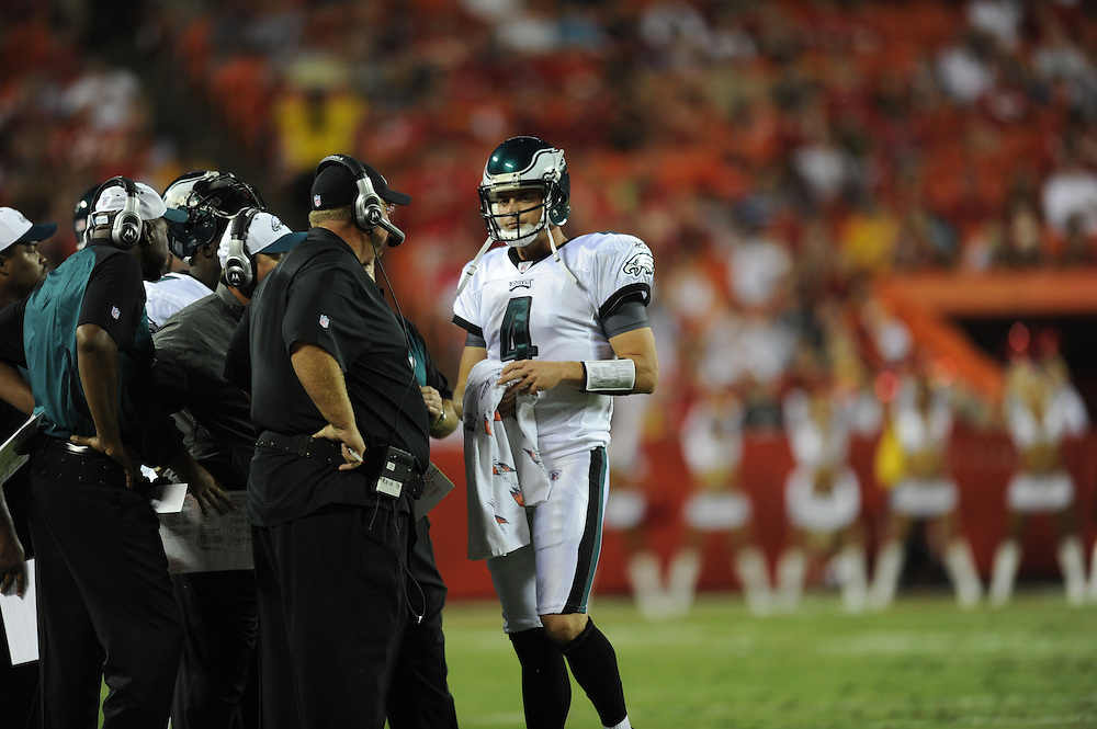 KANSAS CITY, MO - AUGUST 27: Quarterback Kevin Kolb #4 of the Philadelphia Eagles talks to coach Andy Reid during the game against the Kansas City Chiefs on August 27, 2010 at Arrowhead Stadium in Kansas City, Missouri. The Eagles won 20-17. (Photo by Drew Hallowell/Getty Images)  *** Local Caption *** Kevin Kolb;Andy Reid