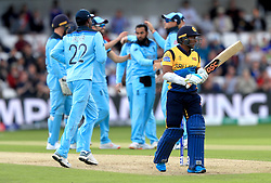 Sri Lanka's Jeevan Mendis (right) walks away after getting out first ball for a golden duck caught and bowled by England's Adil Rashid during the ICC Cricket World Cup group stage match at Headingley, Leeds.