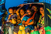 People aboard an auto rickshaw leaving Lathmar Holi (Holi, Festival of Colors), Nandgaon, near Mathura, Uttar Pradesh, India.