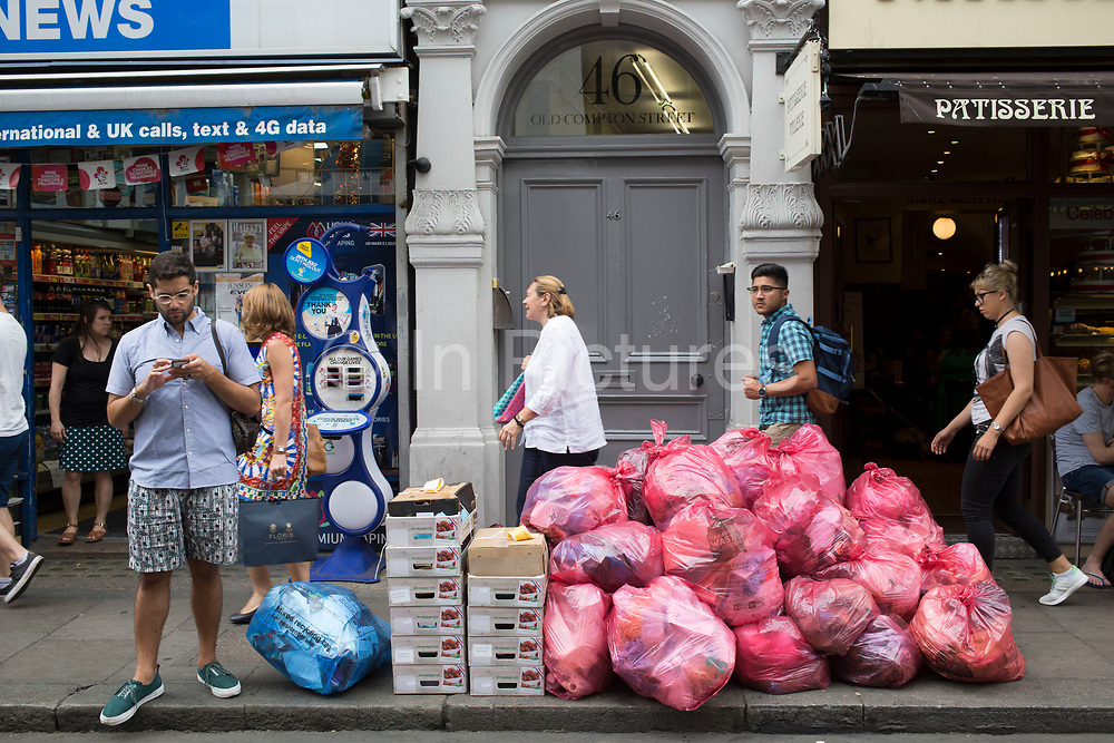 Commercial waste collection rubbish and recycling bags piled high along Old Compton Street in Soho, London, England, United Kingdom. (photo by Mike Kemp/In Pictures via Getty Images)