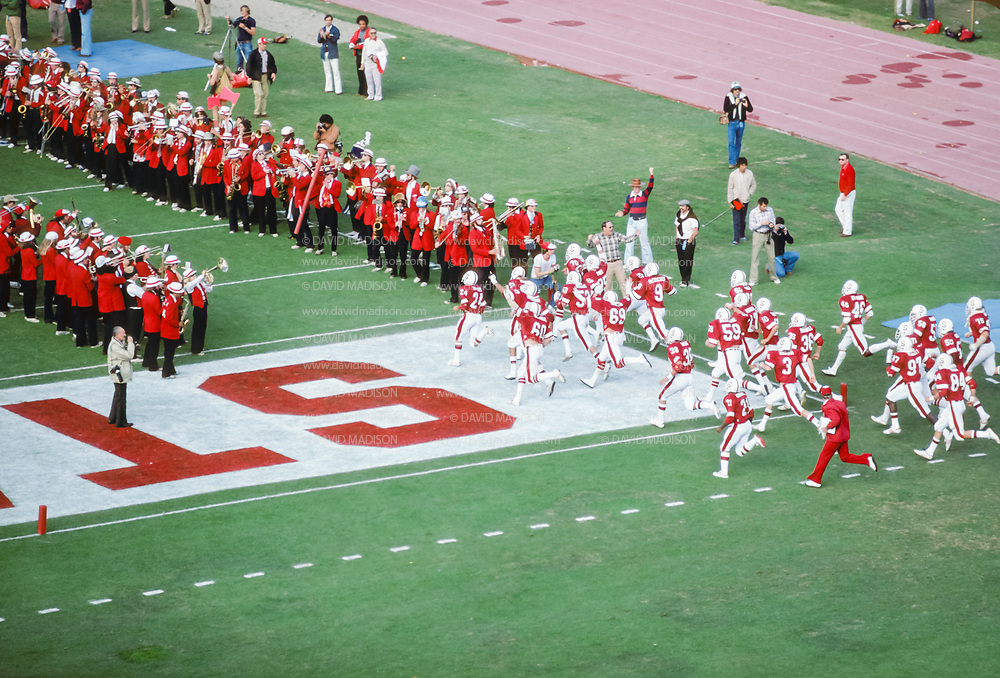 PALO ALTO, CA - NOVEMBER 17:  The Stanford team enters the field before the the 82nd Big Game between Cal and Stanford played on November 17, 1979 at Stanford Stadium in Palo Alto, California.  Visible players include Mike Dotterer #24, Doug Rogers #60, Jon Carroll #21, Joe St. Geme #46.     Photograph by David Madison | www.davidmadison.com.