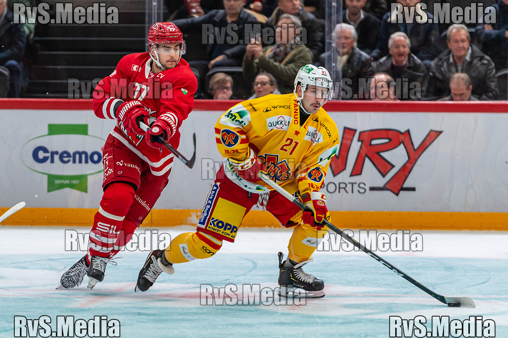 LAUSANNE, SWITZERLAND - NOVEMBER 15: #21 Jason Fuchs of EHC Biel battles for the puck with #77 Robin Grossmann of Lausanne HC during the Swiss National League game between Lausanne HC and EHC Biel-Bienne at Vaudoise Arena on November 15, 2019 in Lausanne, Switzerland. (Photo by Monika Majer/RvS.Media)