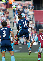 Football - 2016 / 2017 Premier League - West Ham United vs. Middesborough <br /> <br /> Michail Antonio of West Ham rises with Marten de Roon of Middlesborough to win the header  at The London Stadium.<br /> <br /> COLORSPORT/DANIEL BEARHAM