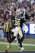 New Orleans Saints cornerback P.J. Williams (26) leaps and breaks up a late fourth quarter pass intended for Los Angeles Rams wide receiver Sammy Watkins (12) in the end zone during the 2017 NFL week 12 regular season football game against the Los Angeles Rams, Sunday, Nov. 26, 2017 in Los Angeles. The Rams won the game 26-20. (©Paul Anthony Spinelli)