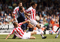 Photo: Chris Ratcliffe.<br />Southend United v Stoke City. Coca Cola Championship.<br />05/08/2006.<br />Clint Hill (on floor) and Darel Russell (R) of Stoke City clashes with Lee Bradbury of Southend.