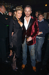Fashion designer SCOTT HENSHALL and HOFIT GOLAN at the 40th birthday party and celebration of 20 years as a leading stylist of David Thomas held at Too2Much club, 11 Walkers Court, London W1 on 22nd March 2006.<br />