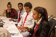 Purchase, NY – 31 October 2014. Early College High School student Victoria Rainford (right) making a point. The Business Skills Olympics was founded by the African American Men of Westchester, is sponsored and facilitated by Morgan Stanley, and is open to high school teams in Westchester County.