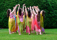 Old Westbury, New York, U.S. 22nd June 2013. Dancers in Lori Belilove & The Isadora Duncan Dance Company, with the Beliloveables, form a circle during a dance at the Midsummer Night event at Old Westbury Gardens, throughout the illuminated grounds of the historic Long Island Gold Coast estate.