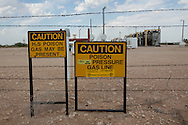 Warning signs at a fracking related instalation site in he Permian Basin in West Texas.
