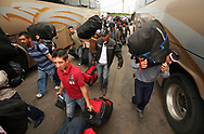 Workers rush to their assigned bus to make the approximately fifty-hour trip home to Nayarit, Mexico. Five buses took hundreds of workers back to their homes all across Mexico.