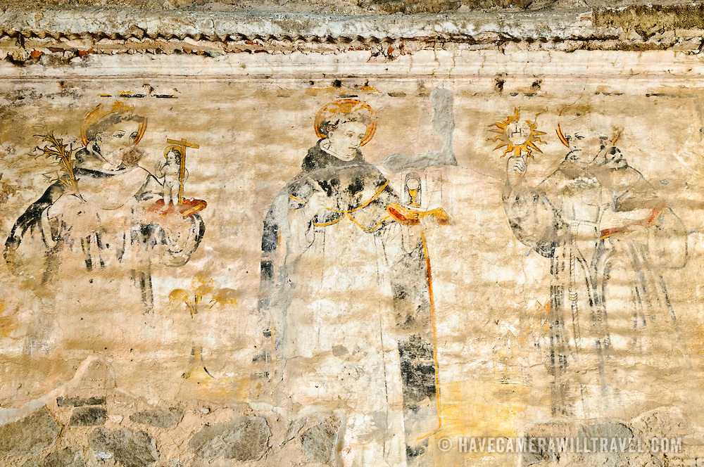 The remnants of a paiting of a Catholic religious scene on a church in Antigua, Guatemala.