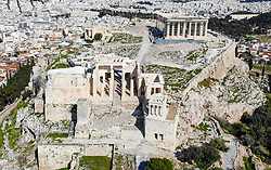 © Licensed to London News Pictures. 19/03/2020 . Athens , Greece . An Aerial view is seen as Acropolis Archaeological site is seen empty due to coronavirus (COVID-19) outbreak. Greece has promised sweeping financial support for businesses shuttered by the coronavirus crisis as store closures were extended Wednesday to most of the country's retail sector.  Photo credit: Ioannis Alexopoulos /LNP