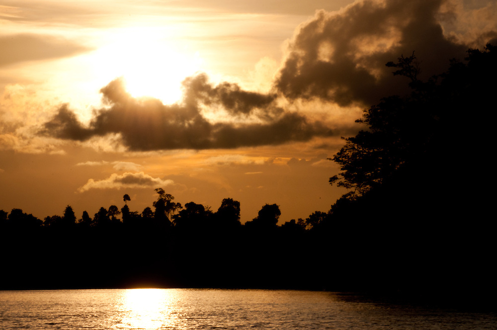 Sunsets over the Kinabatangan River, Sabah, Malaysian Borneo.  This river is bordered by lowland dipterocarp forest that has been largely fragmented by logging and oil palm orchards.