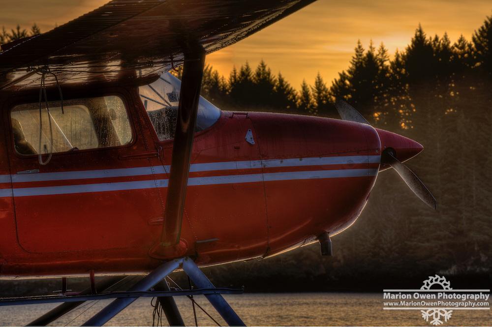 A red seaplane at sunrise, Kodiak, Alaska