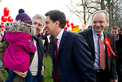 © London News Pictures. 16/02/2013 . Eastleigh, UK.  Leader of the Labour Party, ED MILIBAND (centre) talking to a man and his child while campaigning in Eastleigh town centre Labour candidate, JOHN O'FARRELL (right) ahead of the Eastleigh by-election. Photo credit : Ben Cawthra/LNP