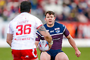 Leeds Rhinos interchange Brett Ferres (19) looks to tackle the oncoming Hull Kingston Rovers winger Justin Carney (36)  during the Betfred Super League match between Hull Kingston Rovers and Leeds Rhinos at the Lightstream Stadium, Hull, United Kingdom on 29 April 2018. Picture by Simon Davies.